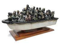 Banksy Raffles Off Refugee Boat Sculpture For £2 - 班克斯·莱佛士为难民船雕塑创作2英镑